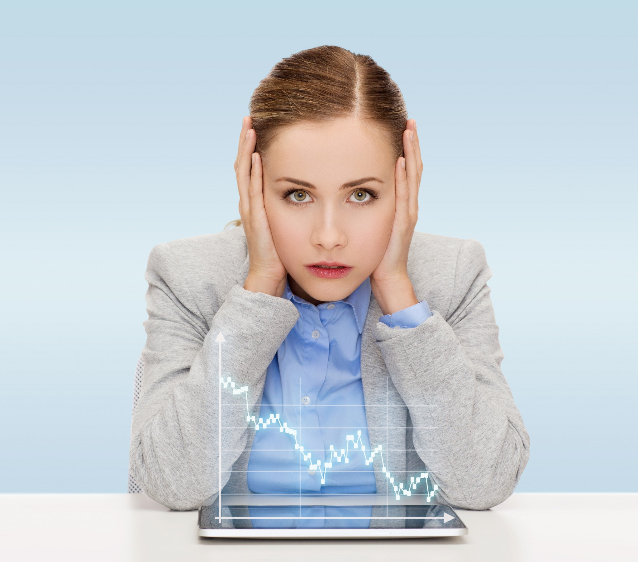business, technology, internet and office concept - businesswoman with tablet pc computer and forex graph over blue background